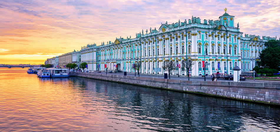 ORSH_Winter Palace building housing Hermitage museum reflects in Neva river on dramatic sunrise, St Petersburg, Russia_950x450