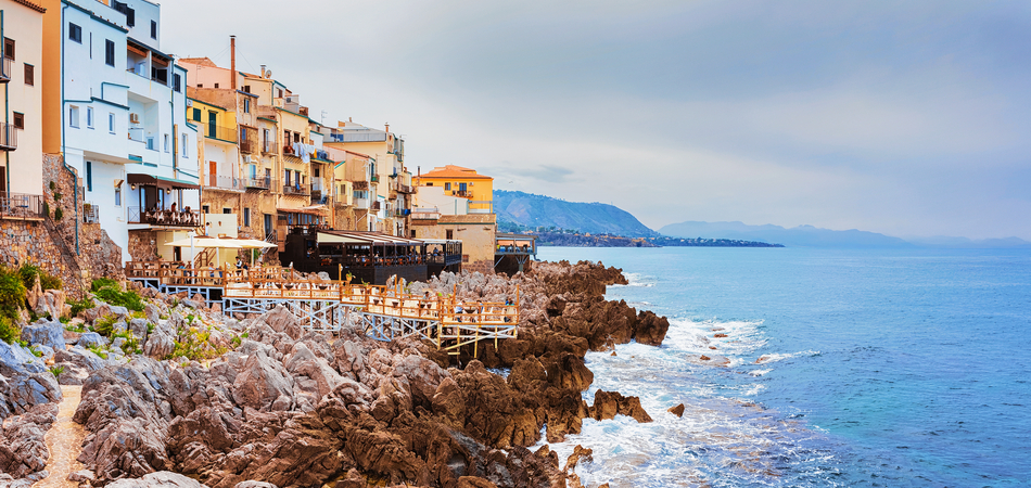 ORSH_Restaurant at Rocky Coast of Cefalu old town, Palermo region, Sicily island of Italy_950x450