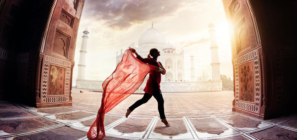 ORSH_Woman with red scarf dancing near Taj Mahal in Agra, Uttar Pradesh, India_950x450