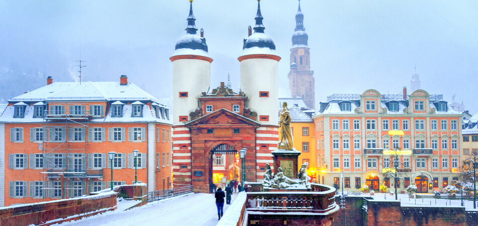 Picturesque baroque style Old Town of Heidelberg, Germany, snow white in winter