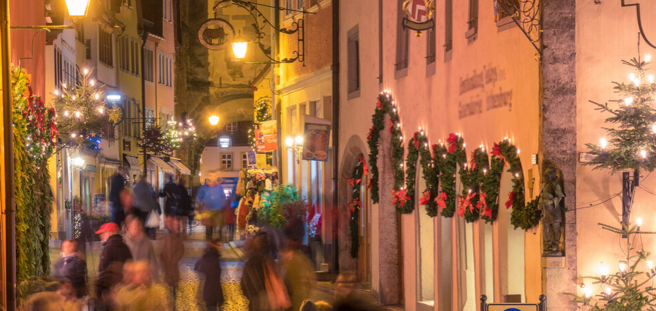 Rothenburg ob der Tauber Christmas night view with blurred crowd of people