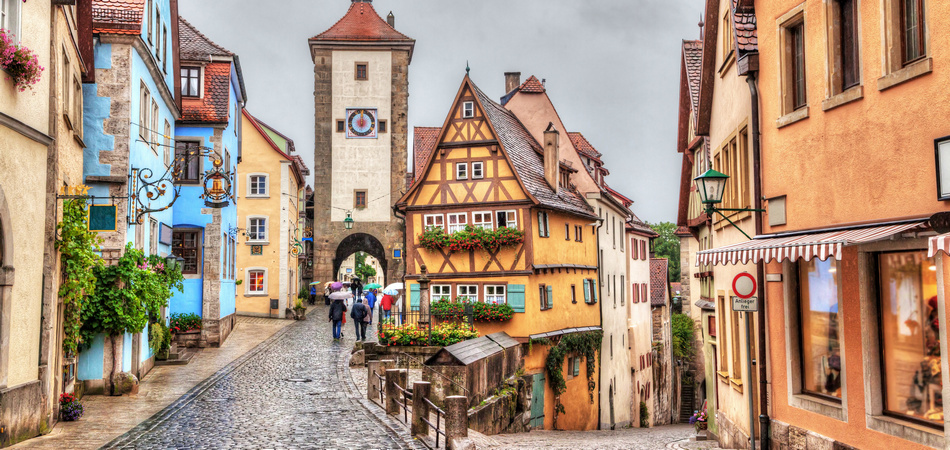 Picturesque view of medieval town Rothenburg ob der Tauber in rainy weather with HDR effect, Bavaria, Germany