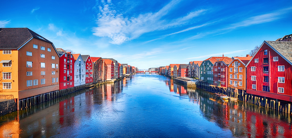 Colorful houses over water in Trondheim city - Norway