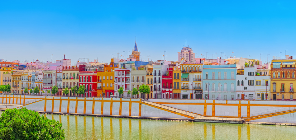 Seville, Spain - June 08, 2017 : View from the coast of the Guadalquivir to the Triana district in Seville. Spain.
