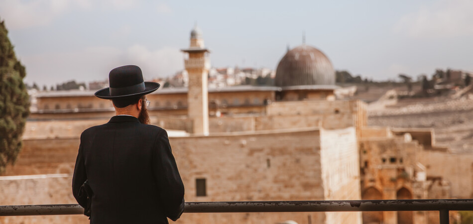 Jerusalem,Israel - November 1st,2016: A rabbi is looking at the Dome of Rock in Jerusalem.The old city of Jerusalem can be seen in th epicture.