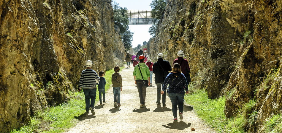 tourists visiting the excavations in the archaeological Atapuerca deposit in Burgos, Spain.